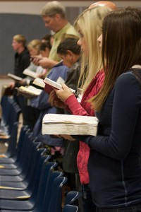 Standing with Bible in hand